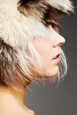 Profile of attractive blond in fur hat — Stock Photo