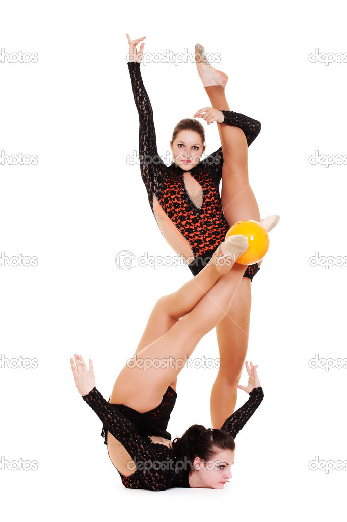 Two pretty gymnasts posing with yellow ball. isolated on white background  — Stock Photo #5181040