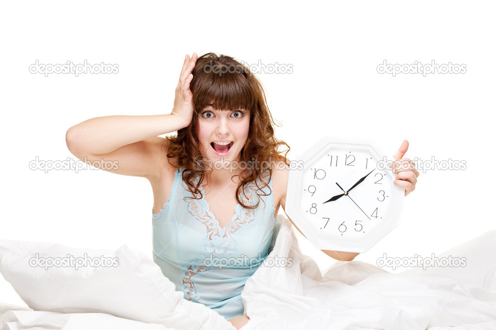 Young startled woman with clock in panic  Stock Photo #5181581