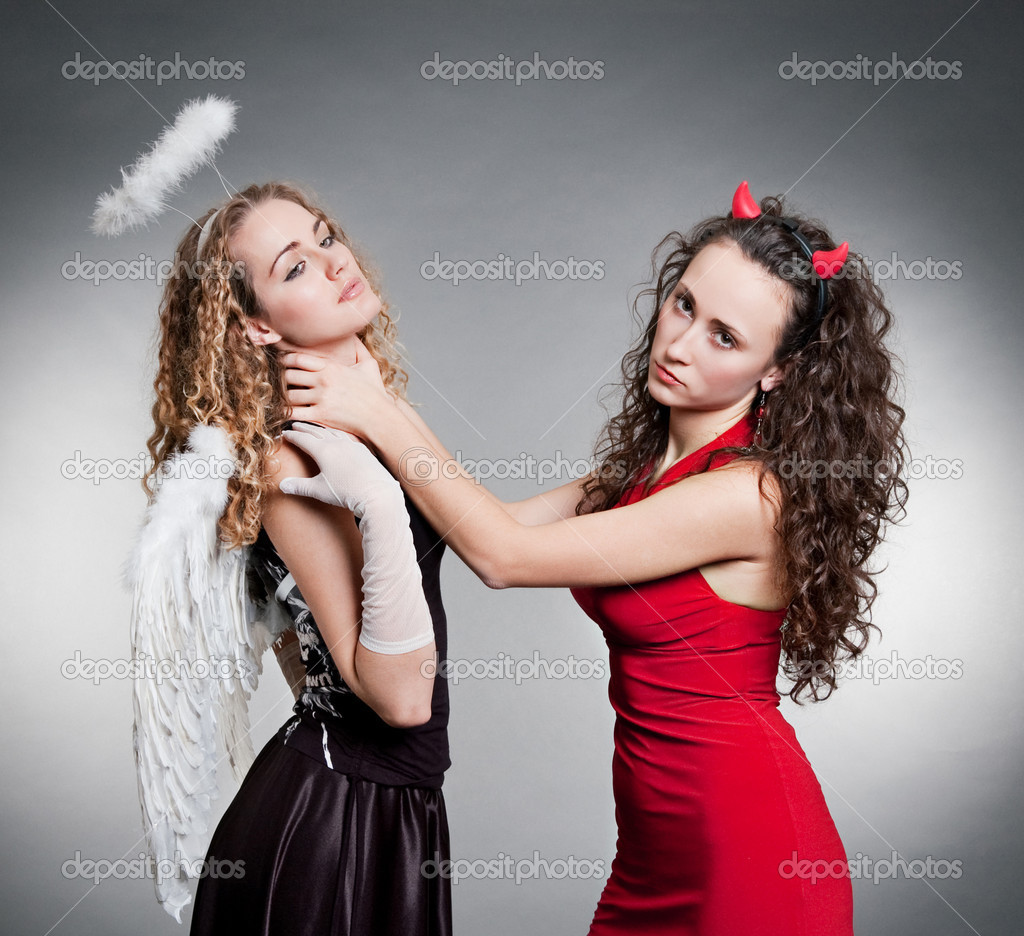 Indifferent Devil Want Strangle Angel Stock Photo
