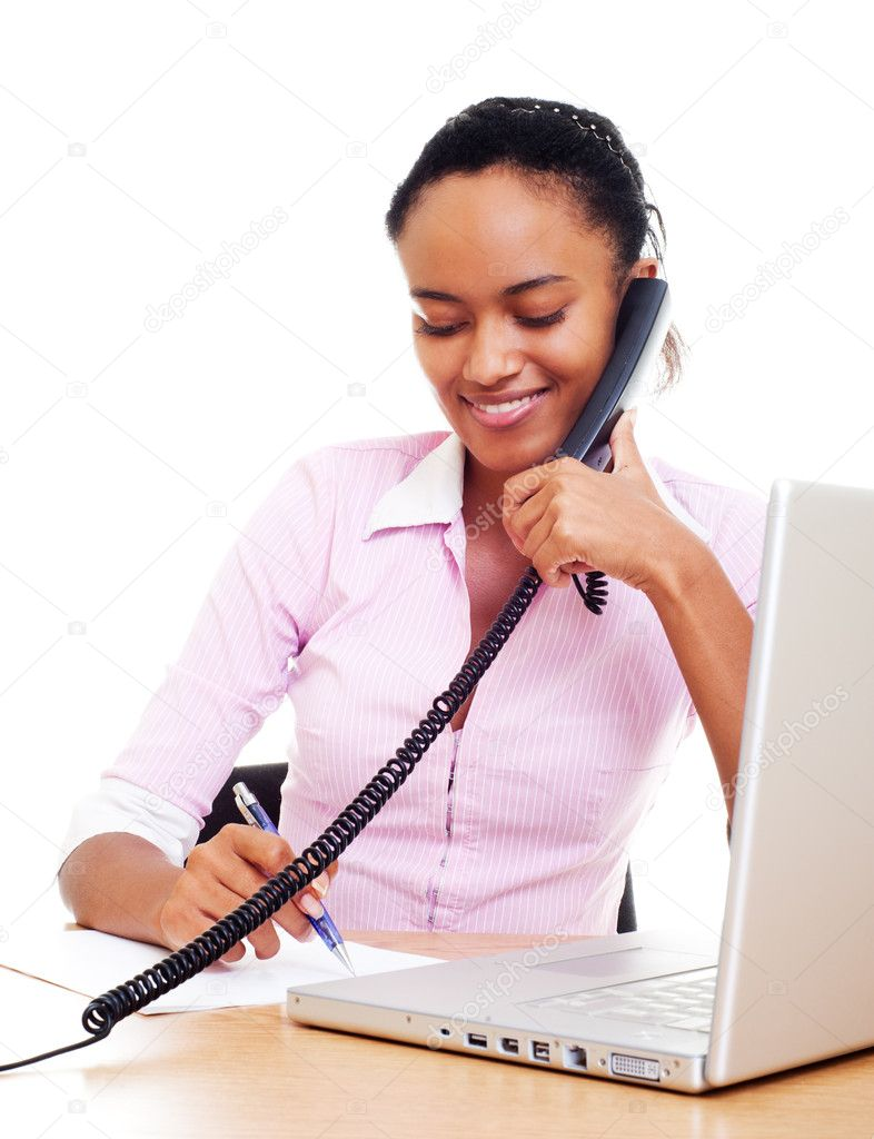 Smiley secretary talking on the phone and writing — Stock Photo #5182400