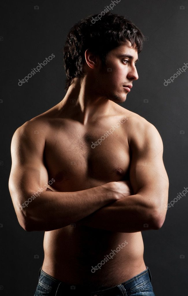 Portrait of handsome thoughtful man with naked torso against dark background — Stock Photo #5182688
