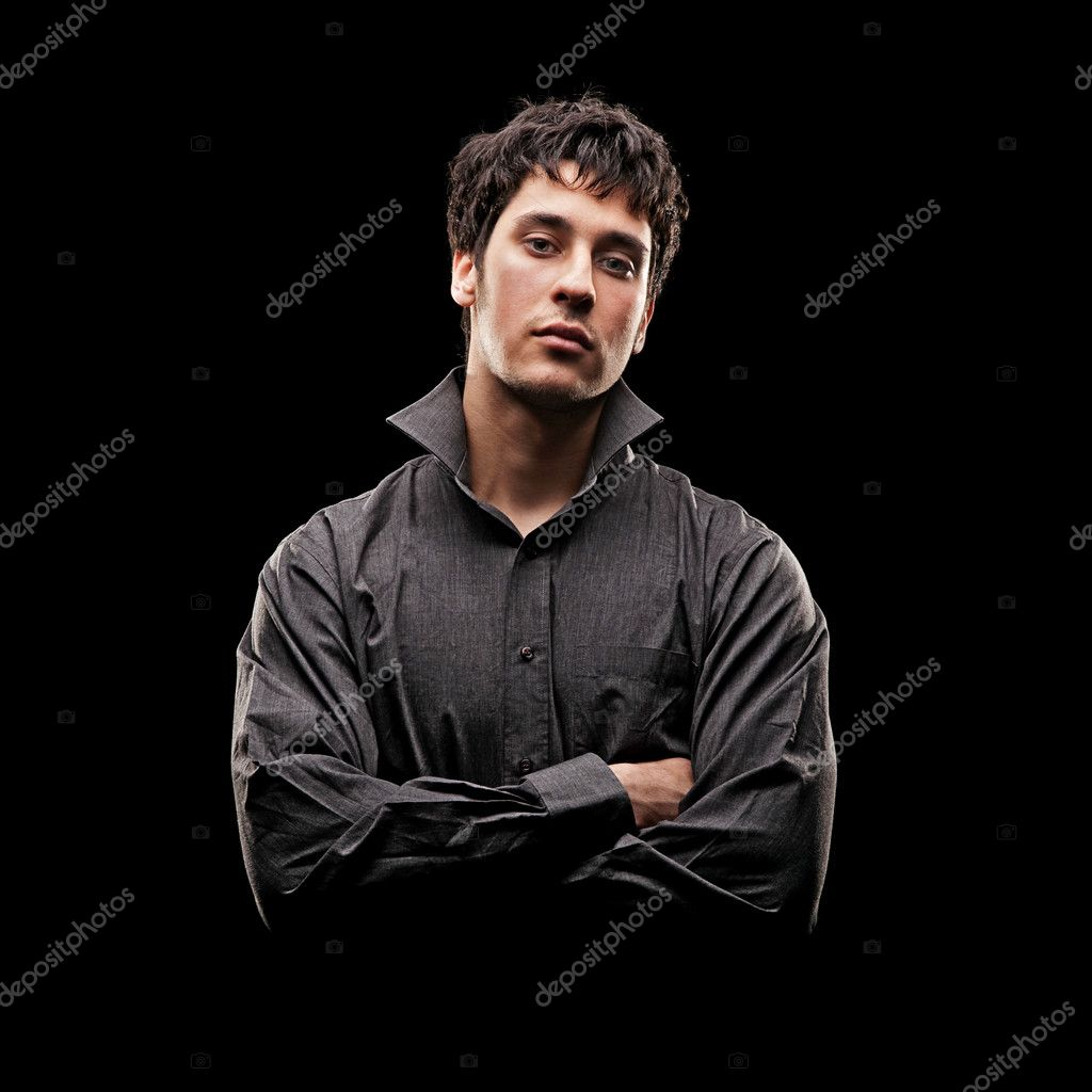Portrait of serious young man in shirt against black background — Stock Photo #5182719