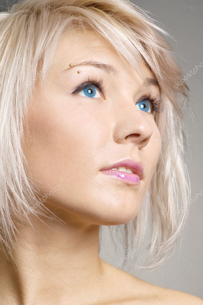 Attractive blond looking with interest at something — Stock Photo #5183381