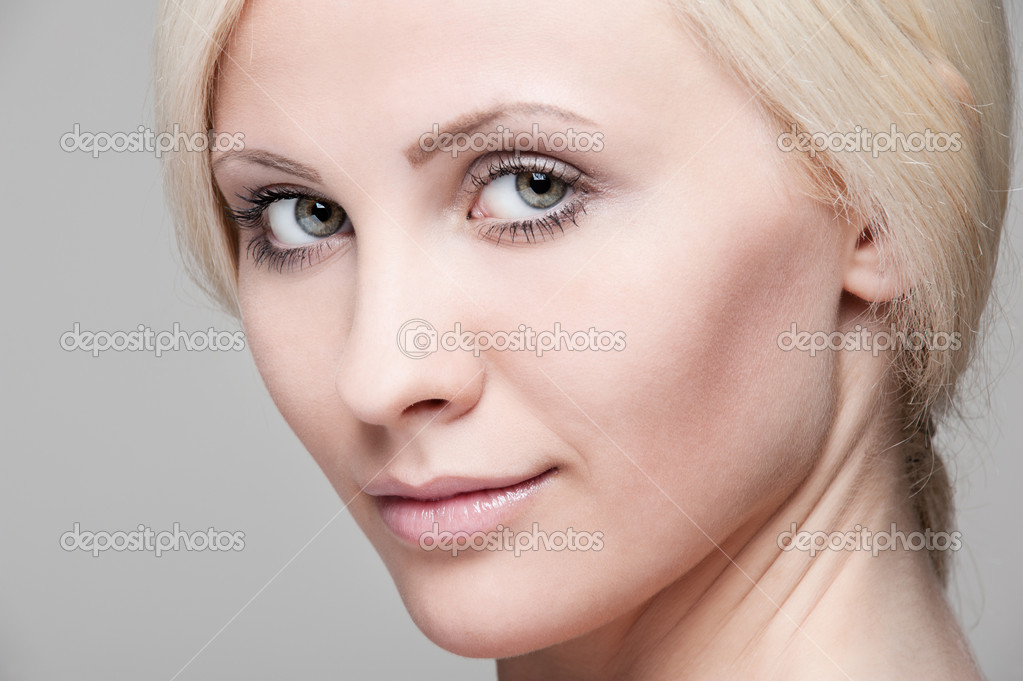 сlose-up portrait of beautiful blonde over grey background  — Stock Photo #5183556