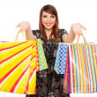 Foto de Stock  : Pretty woman with bright shopping bags