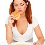 Sad woman with burger and potatoes — Stock Photo #5329651