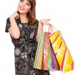 Stock Photo: Smiley woman holding shopping bags