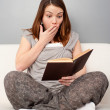 Young woman reading book -  