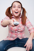 Woman swapping the TV channels — Stock Photo