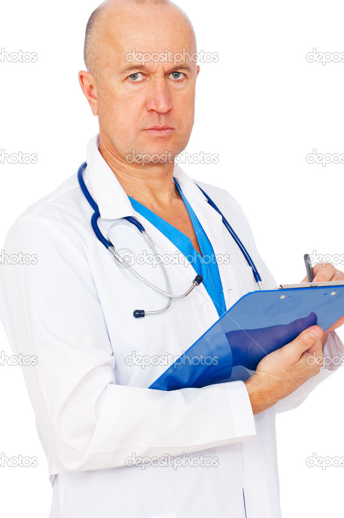 Serious doctor writing report over white background   Stock Photo #5329661