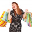 Happy young woman with paper bags — Stock Photo
