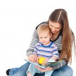 Mother with son sitting on floor — Stock Photo