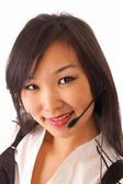 Asian girl with headset — Stock Photo