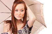 Red haired girl wihh umbrella rose — Stock Photo