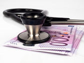 Medical instrument with money — Stock Photo