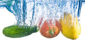 Fruits fell into the water. Close-up — Stock Photo