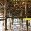 Under a Fishing Pier along the Ocean — Stock Photo