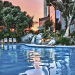 Pool and resort at Sunset - Stock Photo