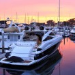 Boats in harbor at sunset — Foto Stock