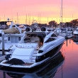 Boats in harbor at sunset — Stockfoto
