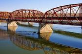 Red Bridge over the Calm River — Stock Photo