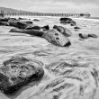 Black and white photo of the coastline — Stock Photo