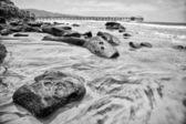 Black and white photo of the coastline — Stock Photo
