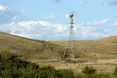 Windmill on Hills of the Praires — Stock Photo
