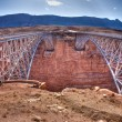 Navajo Bridge over the Colorado River and the Grand Canyon - Stock Photo