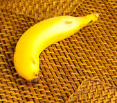 Banana on wicker — Stock Photo