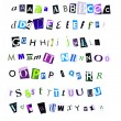 Lowercase magazine cutouts - Stock Photo