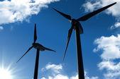 Wind turbines on sunny blue sky — Stock Photo