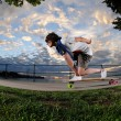 Stock Photo: Young womlongboarding