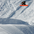 Stock Photo: Snowboarder jumping