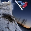 Stock Photo: Jumping snowboarder