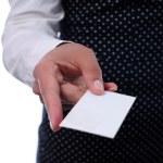 Businesswoman handing a business card — Stock Photo #5117867