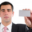 Businessman handing a blank business card — Stock Photo