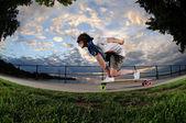 Young woman longboarding — Stock Photo