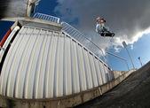 Skateboarder jumping over handrail — Stock Photo