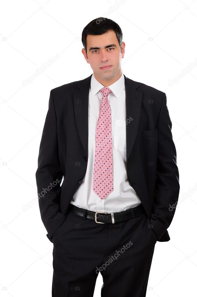 Portrait of a young businessman in a dark open suit with hands in pockets — Stock Photo #5118316
