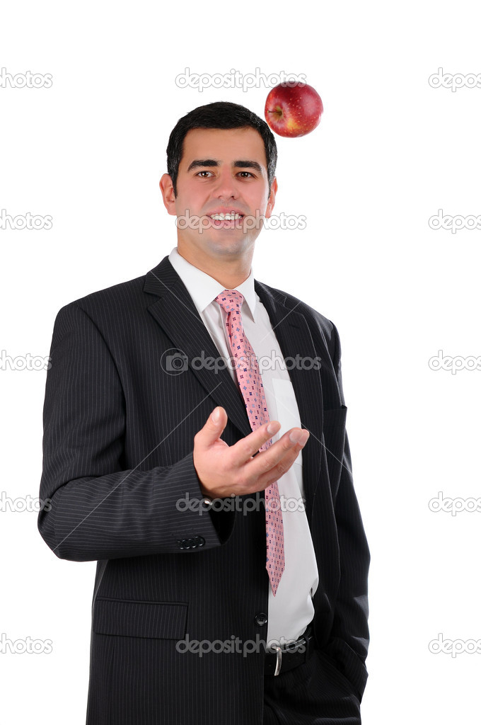 Portrait of a young smiling businessman tossing an apple — Stock Photo #5118350