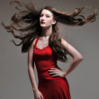 Stock Photo: Fashion model in red dress