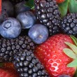 Strawberries blueberries  blackberries mixed — Stock Photo