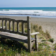 Stock Photo: Bench on beach