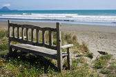 Bench on the beach — Stock Photo