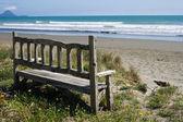 Bench on the beach — Stock Photo