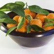 Tangerines in a brown bowl — Stock Photo