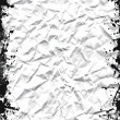 Crushed white sheet with grunge black ink frame — Stock Photo