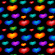 Seamless wallpaper with color hearts — Stock Photo